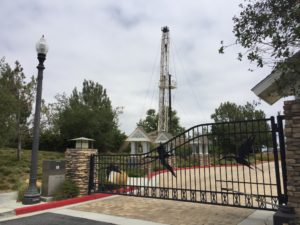 Seal Beach Oil Field Well: A demonstration of how the oil and gas industry is co-existing with an urban environment. Here a workover rig is performing well maintenance adjacent to a community with homes worth $1.1 million - $2.5 million.
